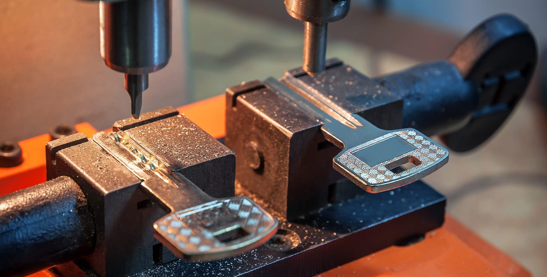 Locksmith in Stirling cutting keys for customer in key machine
