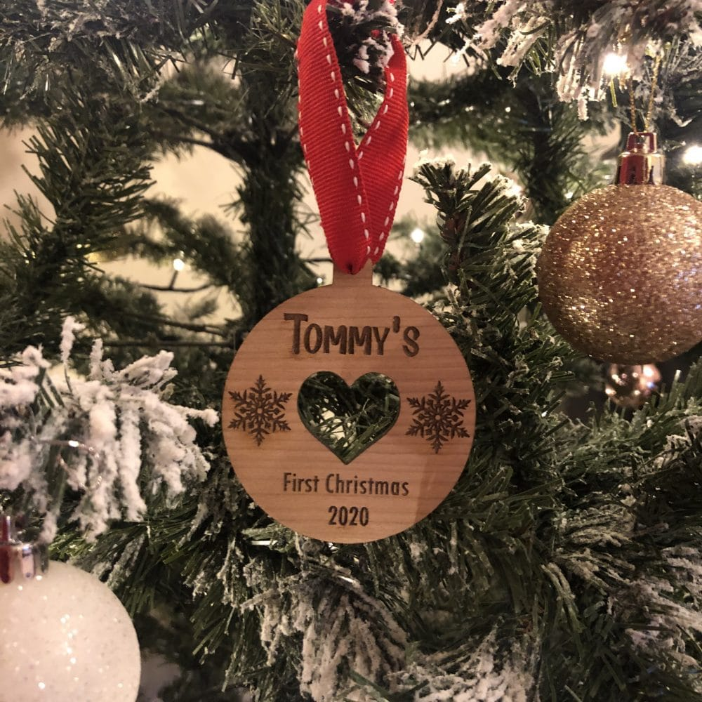 Image of wooden personalised baby's first christmas decoration bobble