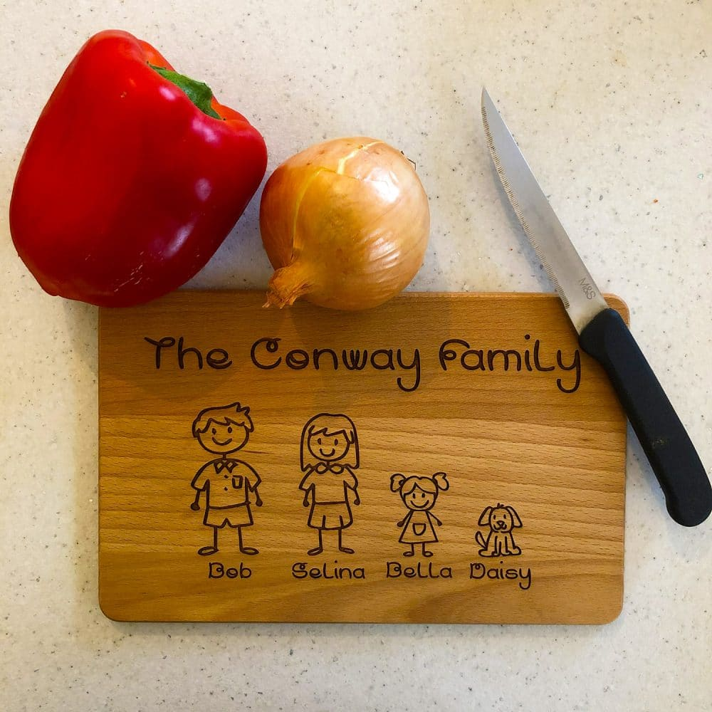 Image of wooden family personalised chopping board with veg