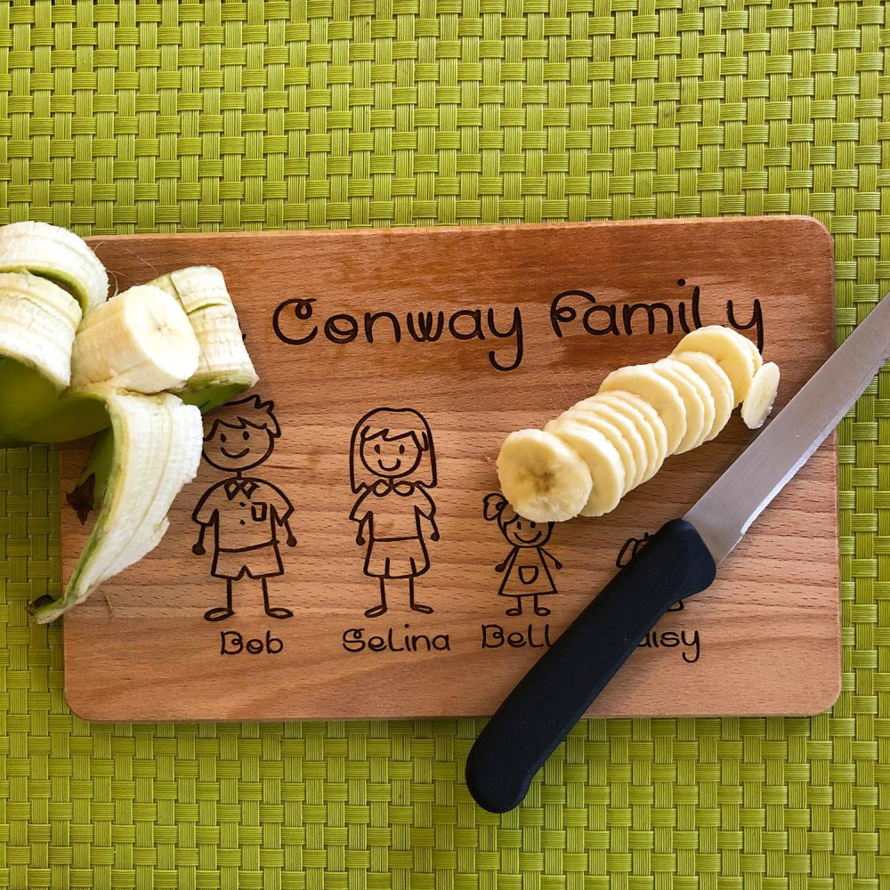 Image of wooden family personalised chopping board with fruit